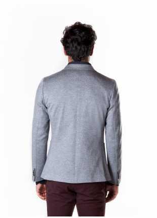 giacca uomo John Barritt vestibilita slim, due bottoni, doppio spacco, bottoni colorati su fondo manica, pochette amf. Tessuto in maglia di cotone misto lana, colore grigio chiaro. Composizione 50% cotone 46% lana 4% poliammide. Grigio Chiaro Melange