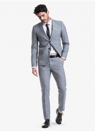 John Barritt spring-summer man suit, slim fit, two buttons, double vent and amf. Lenght jacket 72 cm. Mixed wool fabric with micro pied de poule pattern. Composition 70% wool 30% polyester. Blue Paper From Sugar