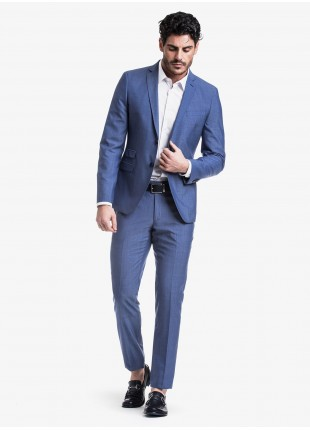 John Barritt spring-summer man suit, slim fit, two buttons, double vent, ticket pocket and amf. Lenght jacket 72 cm. Mixed wool fabric. Composition 70% wool 30% polyester. Blue Paper From Sugar