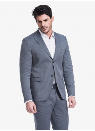 John Barritt man jacket, slim fit, full body lining, two buttons, double vent, flap pockets, peak lapel. Stretch cotton fabric with micro design. Color blue. Composition 97% cotton 3% elastane. Blue