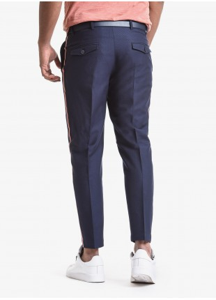 John Barritt man pants, baggy fit, slant side pockets on front and small flap pockets on back. Colored tape applied on the side of leg. Embossed fabric. Composition 50% cotton 28% polyester 22% polyamide. Blue