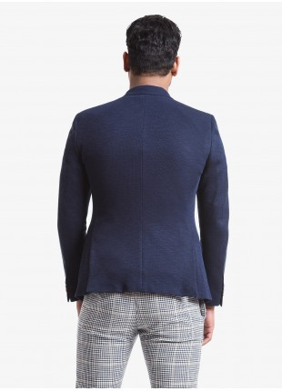 John Barritt man jacket, slim fit, full body lining, two buttons, double vent, flap pockets, pochette. Jersey fabric with micro design. Color blue. Composition 80% cotton 20% polyester. Blue