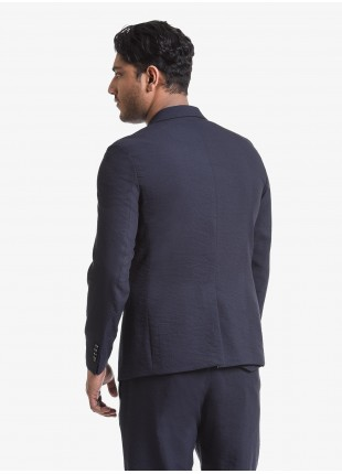 John Barritt man jacket, slim fit, peak lapel, full body lining, two buttons, double vent, flap pockets and amf. Light embossed fabric, mono stretch. Composition 43% viscose 42% polyester 15% polyamide. Blue