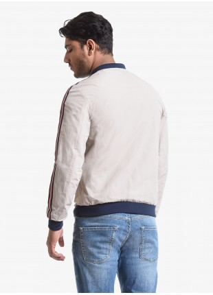 John Barritt man jacket, bomber style, slim fit, lining with mesh fabric, welt pockets and colored tape applied on the sleeves. Color beige. Composition 58% polyester 42% cotton. Beige