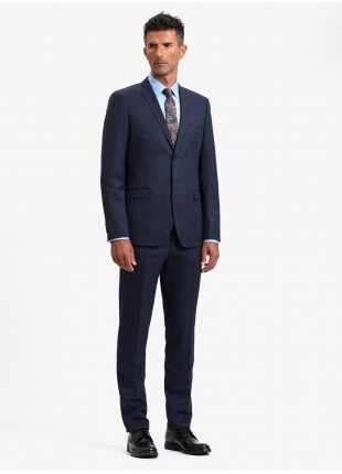 John Barritt autumn-winter man suit, slim fit, two buttons, double vent and amf. Lenght jacket 74 cm. Mixed wool fabric with micro design. Color blue. Composition 70% wool 30%polyester. Bluette