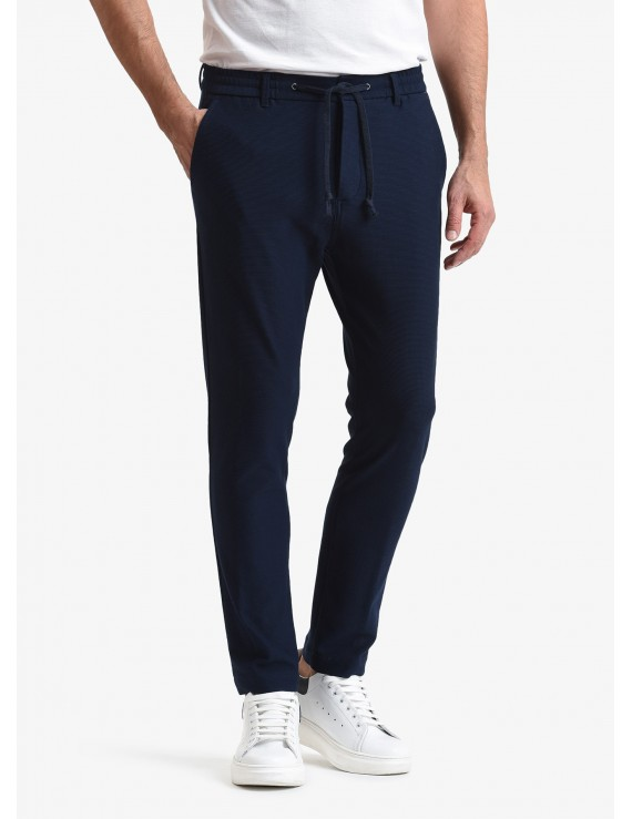 John Barritt man pants, slim fit, waistband with elastic inside and coulisse, american pockets on front and welt pockets on back. Jersey fabric with micro design. Color dark blue. Composition 100% cotton. Bluette