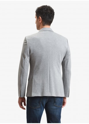 John Barritt man jacket, slim fit, full body lining with shoulder pads, two buttons, double vent, flap pockets, pochette and amf. Cotton jersey fabric, color melange grey. Composition 100% cotton. Light Grey Melange