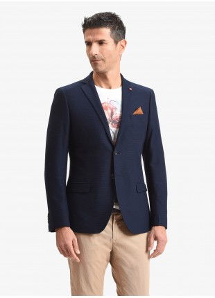 John Barritt man jacket, slim fit, full body lining with shoulder pads, two buttons, double vent, flap pockets, pochette and amf. Jersey fabric with micro design. Color dark blue. Composition 100% cotton. Bluette