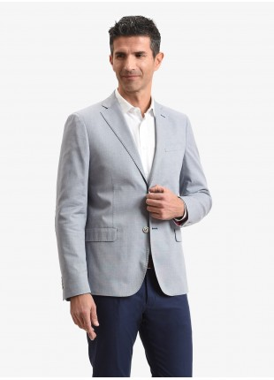 John Barritt man jacket, slim fit, full body lining with shoulder pads, two buttons, double vent, flap pockets, amf and alcantara patches on contrast. Cotton stretch fabric. Color light blue. Composition 98% cotton 2% elastane. Blue Paper From Sugar