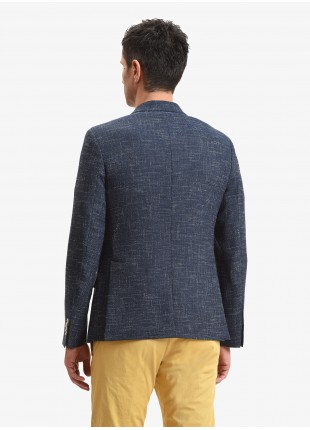 John Barritt man jacket, slim fit, half body lining with shoulder pads, two buttons, double vent, flap pockets, pochette and amf. Mixed wool/cotton fabric, color blue. Composition 47% wool 34% polyester 19% cotton. Bluette