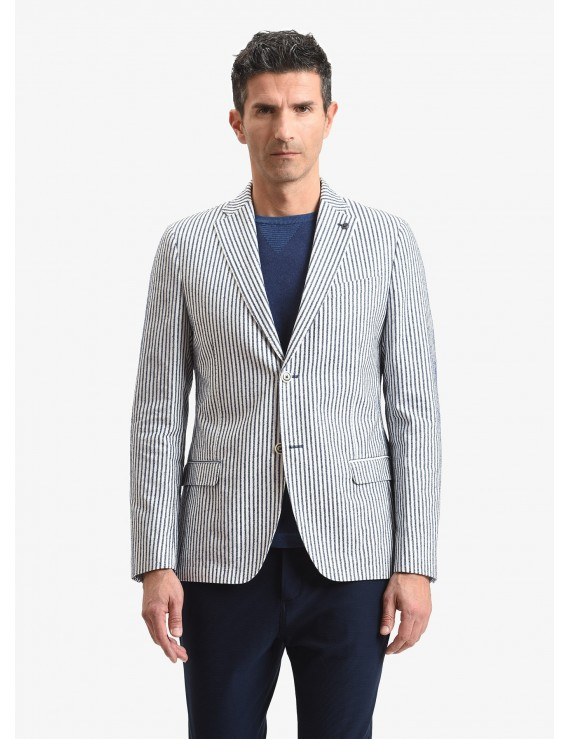 John Barritt man jacket, slim fit, half body lining with shoulder pads, two buttons, double vent, flap pockets, pochette and amf. Cotton fabric with striped design, color white/blue. Composition 92% cotton 8% polyamide. White