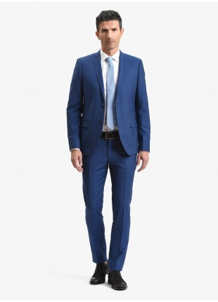 John Barritt spring-summer man suit, slim fit, two buttons, double vent and amf. Lenght jacket 72 cm. Mixed wool fabric. Color blue. Composition 70% wool 30% polyester. Bluette