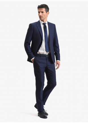 John Barritt spring-summer man suit, slim fit, two buttons, double vent and amf. Lenght jacket 72 cm. Mixed wool fabric with micro design. Color blue. Composition 70% wool 30% polyester. Blue