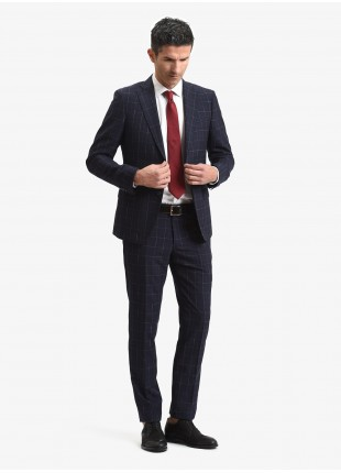 John Barritt spring-summer man suit, slim fit, two buttons, double vent and amf. Lenght jacket 72 cm. Mixed wool fabric with check design. Color dark blue and red check. Composition 62% wool 37% polyester 1% cotton. Blue