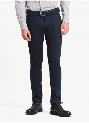 John Barritt man chinos, slim fit, slant side pockets on front and welt pockets with buttons on back. Stretch jersey fabric. Color blue. Composition 53% polyester 43% viscose 4% elastane. Blue