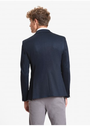 John Barritt man jacket, slim fit, full body lining, two buttons, double vent, flap pockets, amf. Stretch jersey fabric. Color blue. Composition 53% polyester 43% viscose 4% elastane. Blue