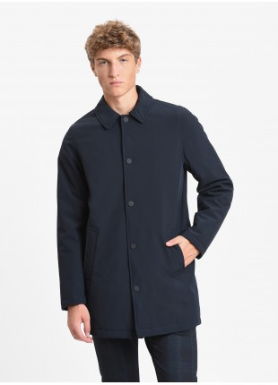 John Barritt man coat with synthetic quilted filling inside, collar shirt, front closure by buttons and zip, welt pockets and vent on back. Color blue. Composition 88% polyamide 12% elastane. Blue