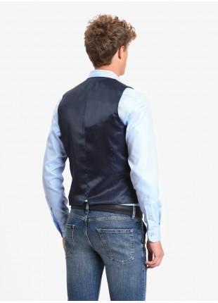 Gilet uomo John Barritt, vestibilita slim, tasche a pattina. Tessuto in jersey stretch con micro fantasia pied-de-poule, colore blu. Composizione 62% cotone 35% poliestere 3% elastan. Blue