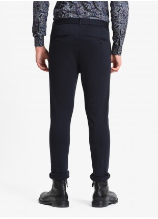 John Barritt man pants, slim fit, waistband with elastic inside and coulisse, american pockets on front and welt pockets on back. Jersey fabric, color blue. Composition 100% cotton. Blue