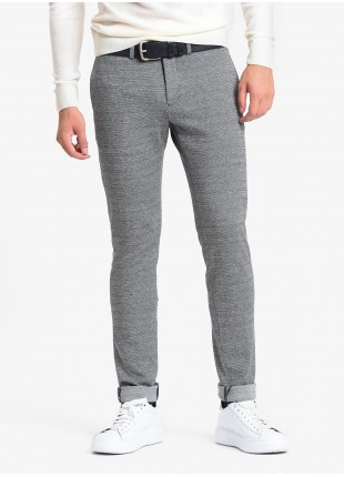 John Barritt man chinos, slim fit, slant side pockets on front and welt pockets with buttons on back. Jersey fabric with micro design. Color grey/blue. Composition 100% cotton. Blue Paper From Sugar