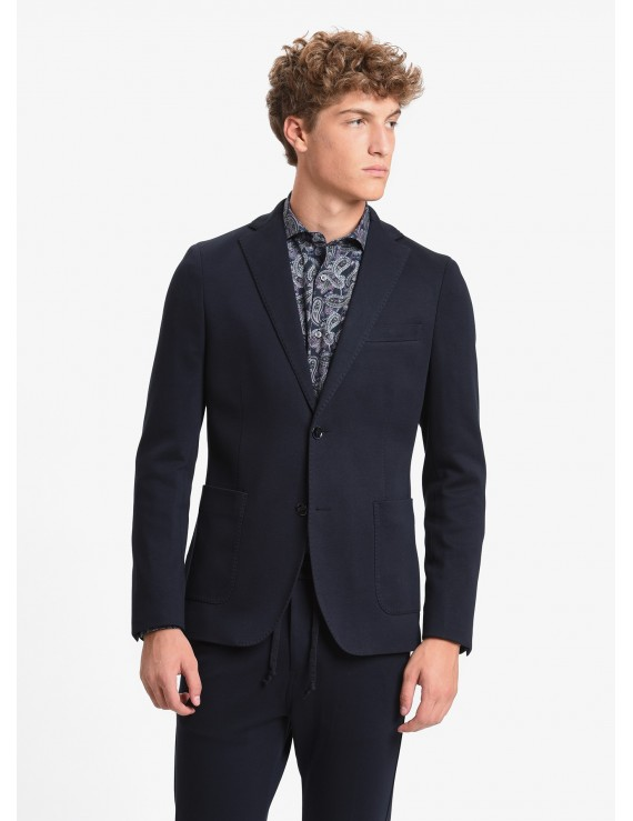 John Barritt man jacket, slim fit, full body lining, two buttons, double vent, patch pockets, amf. Jersey fabric, color blue. Composition 100% cotton. Blue