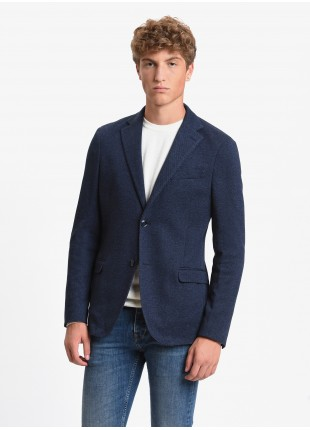 John Barritt man jacket, slim fit, half body lining, two buttons, double vent, flap pockets, amf. Jersey fabric with micro design. Color grey/blue. Composition 100% cotton. Bluette