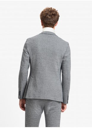 John Barritt man jacket, slim fit, half body lining, two buttons, double vent, flap pockets, amf. Jersey fabric with micro design. Color grey/blue. Composition 100% cotton. Blue Paper From Sugar