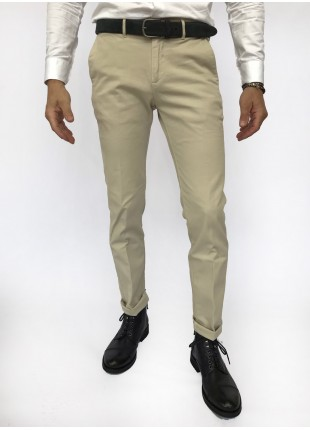 Man chinos pants, slim fit, in stretch cotton fabric, garment dyed . Cream/beige colour. Composition 97% cotton 3% elastane. White