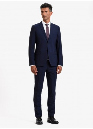 John Barritt autumn-winter man suit, slim fit, two buttons, double vent and amf. Lenght jacket 72 cm. Mixed wool fabric. Color blue. Composition 50% wool 35% polyester 10% cupro 5% elastane. Bluette